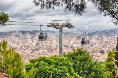 Montjuic Cable Cars and cityscape on background, Barcelona, Catalonia, Spain Stock Photo