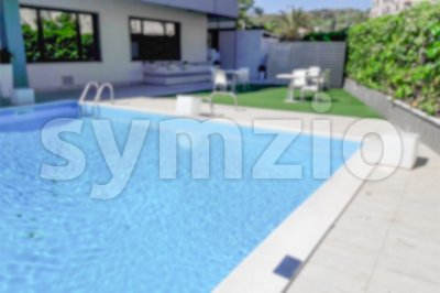 Defocused background of a swimming pool inside a resort Stock Photo