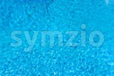 Defocused background with blue water surface of a swimming pool Stock Photo