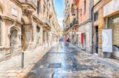 Defocused background of street in Ribera district, Barcelona, Catalonia, Spain Stock Photo