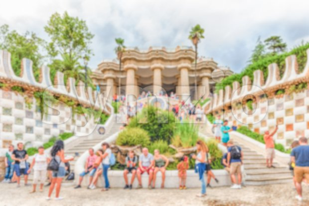 Defocused background with main entrance and staircase of Park Guell, Barcelona, Catalonia, Spain. Intentionally blurred post production for bokeh effect