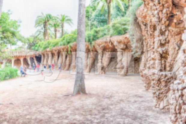 Defocused background of colonnaded pathway, Park Guell, Barcelona, Catalonia, Spain Stock Photo