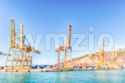 Defocused background of container cranes in Barcelona, Catalonia, Spain Stock Photo