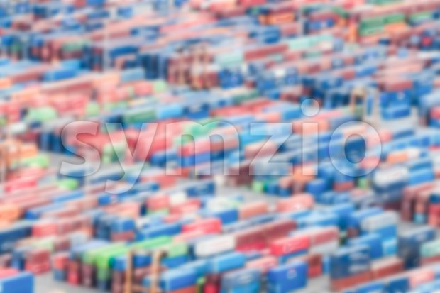 Defocused background of shipping containers stacked on a commercial port Stock Photo