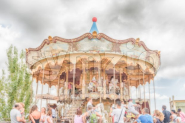 Defocused background of old vintage carousel at in amusement park Stock Photo