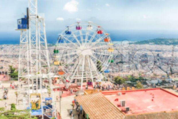 Defocused background of an amusement park Stock Photo