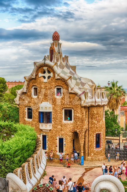 BARCELONA - AUGUST 9: Gingerbread house, modernist building at the entrance of Park Guell in Barcelona, Catalonia, Spain, on August ...