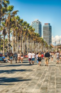 Walking on the promenade of Barceloneta beach, Barcelona, Catalonia, Spain Stock Photo