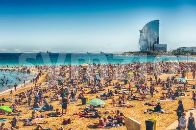A sunny day on the Barceloneta beach, Barcelona, Catalonia, Spain Stock Photo