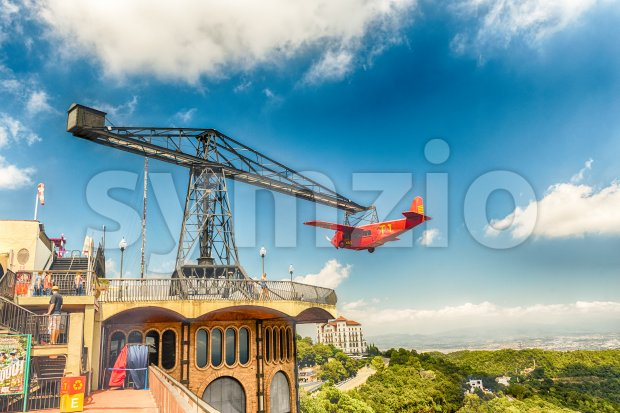 Red airplane carousel at Tibidabo Amusement Park, Barcelona, Catalonia, Spain Stock Photo