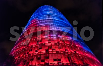 Torre Glories, formerly Agbar, by night in Barcelona, Catalonia, Spain Stock Photo