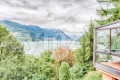 Defocused background with scenic landscape over the Lake Como, Italy Stock Photo