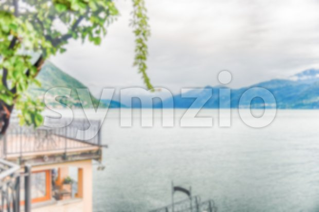 Defocused background with view over Lake Como from Varenna, Italy Stock Photo