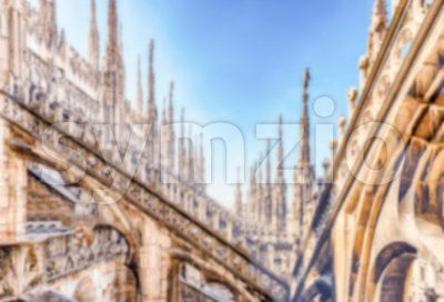 Defocused background with spiers of the Cathedral of Milan, Italy Stock Photo