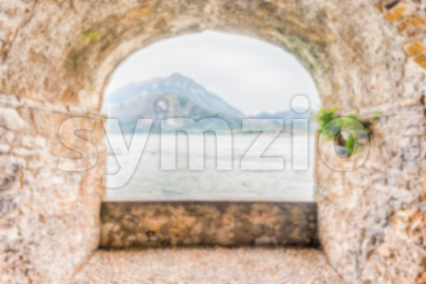 Defocused background of rock balcony facing Lake Como, Varenna, Italy Stock Photo