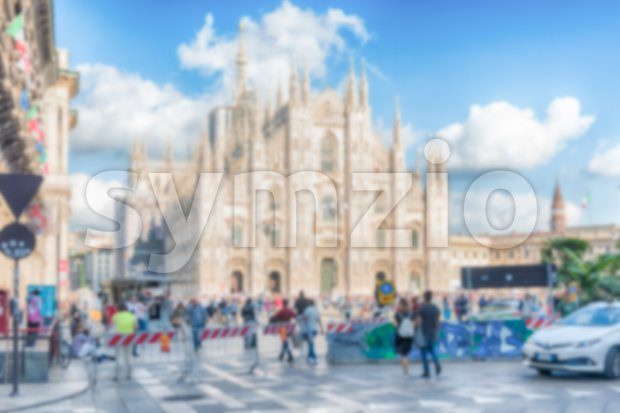 Defocused background with the gothic cathedral, aka Duomo, iconic landmark in Milan, Italy. Intentionally blurred post production for bokeh effect