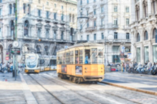 Defocused background with trams operating in Milan, Italy Stock Photo
