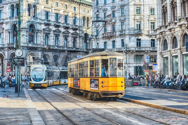 MILAN - SEPTEMBER 11: Iconic trams operating in the city centre of Milan, Italy, on September 11, 2017