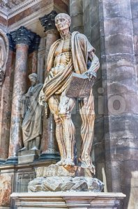 Statue of Bartholomew the Apostle inside Milan Cathedral, Italy Stock Photo