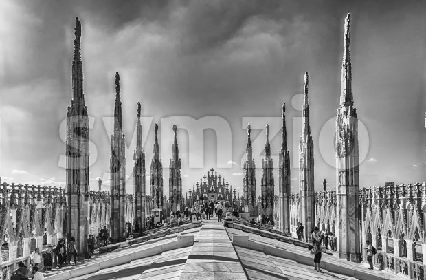 MILAN - SEPTEMBER 11: Tourists on the roof terrace of the gothic Cathedral, iconic landmark of Milan, Italy, September 11, ...