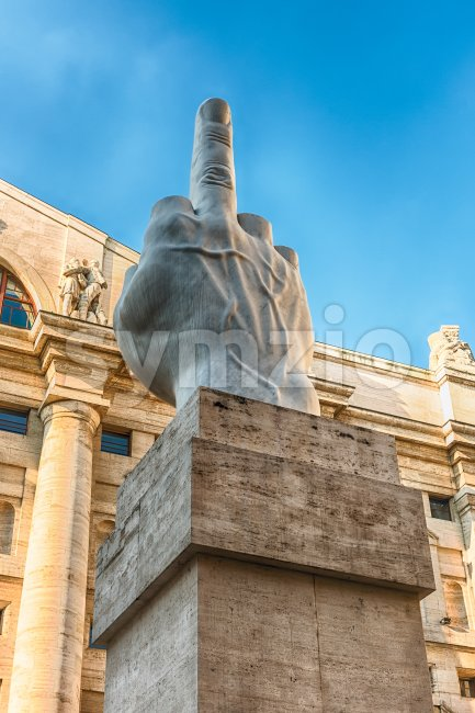 L.O.V.E. sculpture by M. Cattelan in Piazza Affari, Milan, Italy Stock Photo