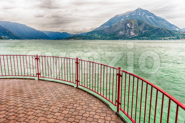 Scenic red balcony over the landscape of Lake Como in the town of Varenna, Italy