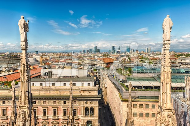 Scenic aerial view over the city centre, as seen from the roof of the gothic Cathedral, Milan, Italy