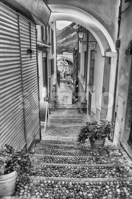Scenic alley in the picturesque village of Bellagio on the eastern shore of Lake Como, Italy