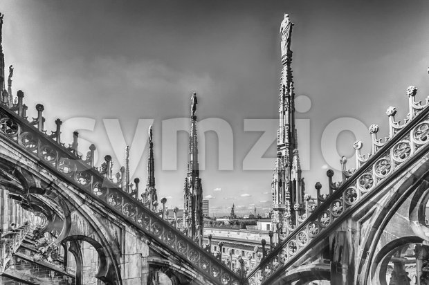 Spiers and statues on the gothic Cathedral of Milan, Italy Stock Photo