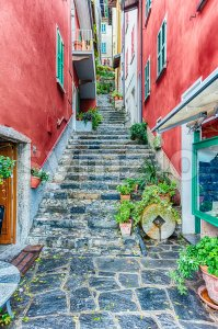 Scenic alley in Varenna town, Lake Como, Italy Stock Photo